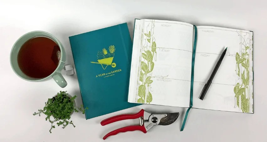 a year in the garden journal on a white table