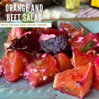 roasted beets, oranges, and mint on light blue plate