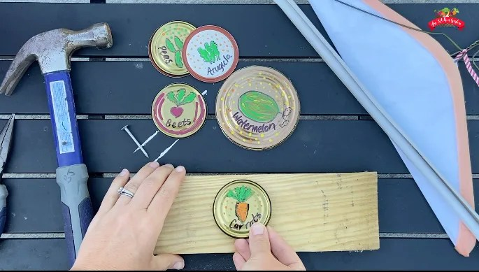 Can lid garden markers on wood block