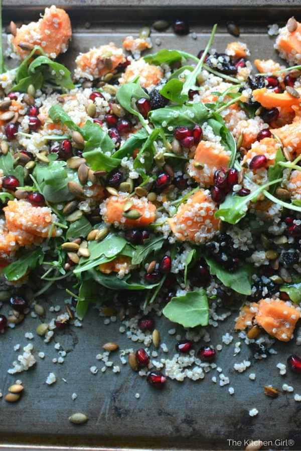 Stay nourished through winter with quinoa, pomegranate, dried cherries, arugula, and pumpkin seeds in apple cider vinaigrette. Fall and Winter Sweet Potato Salad #quinoasalad #pomegranate #thanksgiving #christmas #holidaysalad