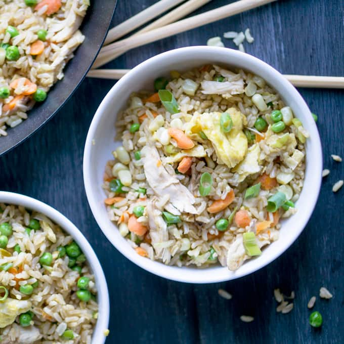 Feed your army on a budget with healthy, Skip the Takeout Chicken Fried Brown Rice. thekitchengirl.com #skilletmeal #oneskillet #asianrecipes #glutenfreedinner #budgetrecipe
