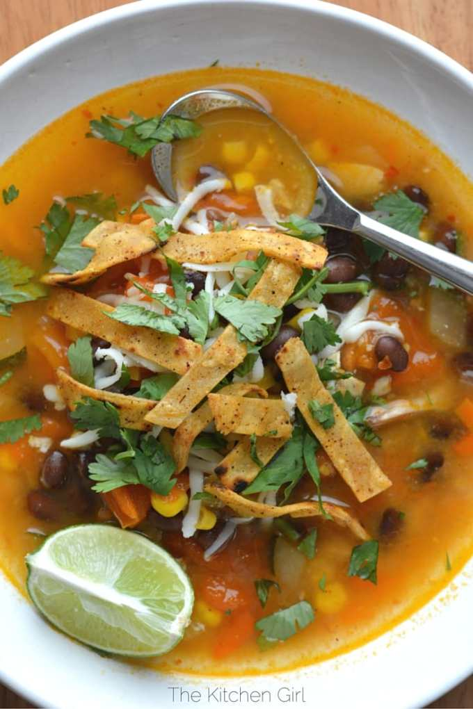 30 Minute Chicken Tortilla Soup uses rotisserie chicken, tomatoes, lime, cilantro, black beans, and corn. Gluten-free. thekitchengirl.com