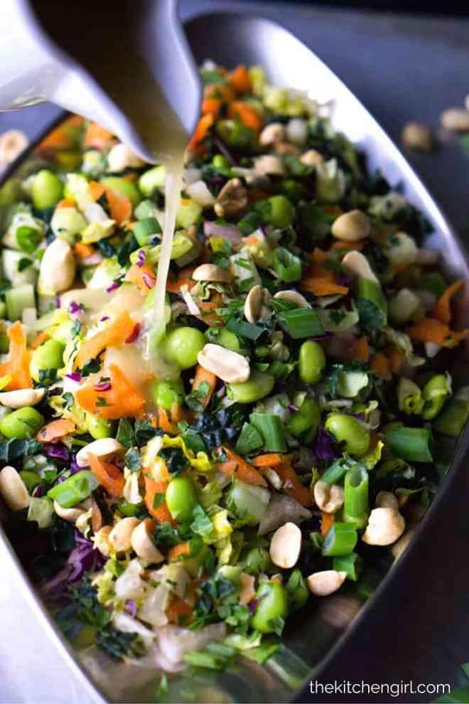 Raw veggie LOADED Thai salad for clean eating meal prep. Chopped Thai Salad with Chili Ginger Vinaigrette on thekitchengirl.com. #vegan #glutenfree #mealprep #meatlessmonday #cleaneating #asiansalad