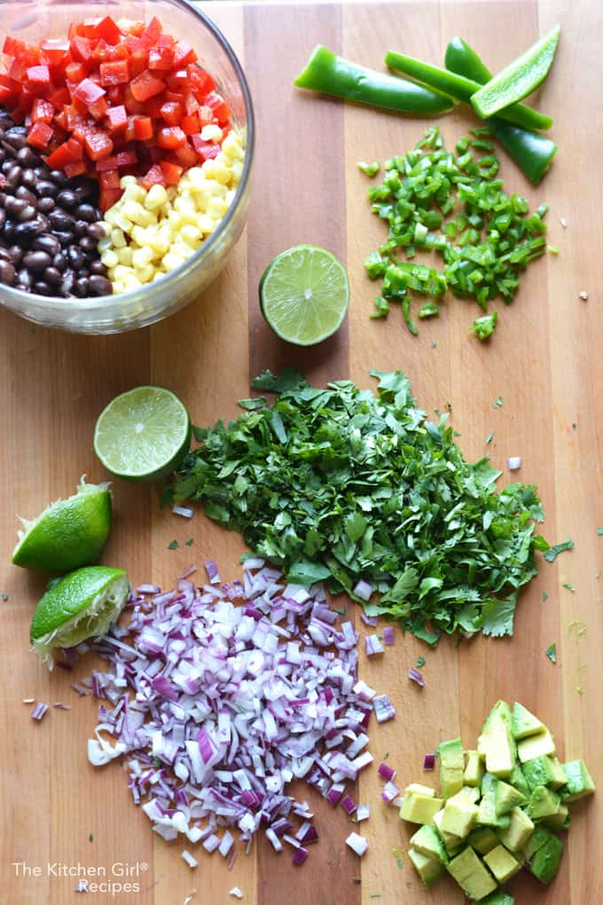 Healthy tex mex in 15 minutes! Mexican Black Bean Corn Avocado Salsa is like Cowboy Caviar with avocado. thekitchengirl.com #cowboycaviar #texmex #salsa #Mexicandip #blackbean #avocado #mexicanrecipe #healthypartyfood
