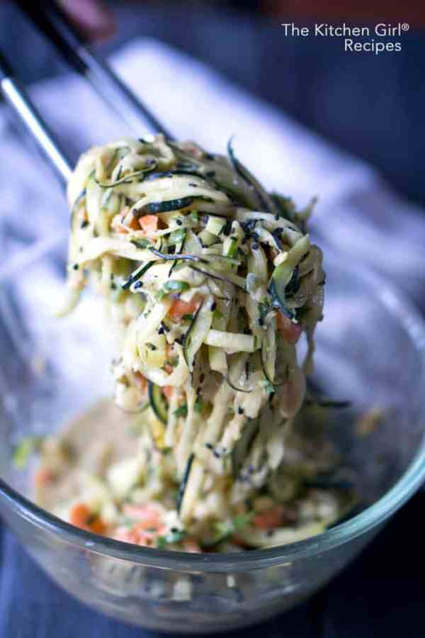 Easy, scrumptious, ready in 30! Vegan Thai Peanut Zucchini Noodles made with carrots and onions tossed in a spicy peanut butter sauce #thainoodles #asiannoodles #zucchininoodles #glutenfree #zoodles