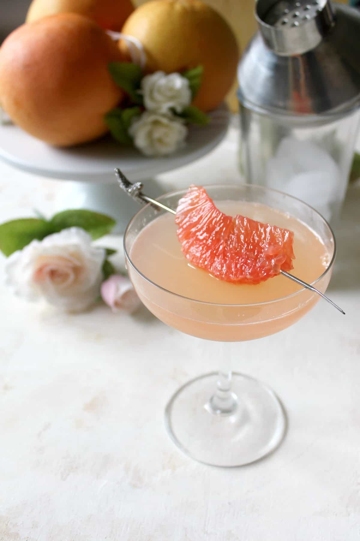 This Grapefruit Ginger Cocktail makes a refreshing elixir with a mildly spicy zing. Fresh squeezed grapefruit juice lends citrusy sweetness to the drink, while ginger beer gives the unassuming beverage effervescence and a touch of heat. Mix it up to sip on for a special celebration or a weekend treat!