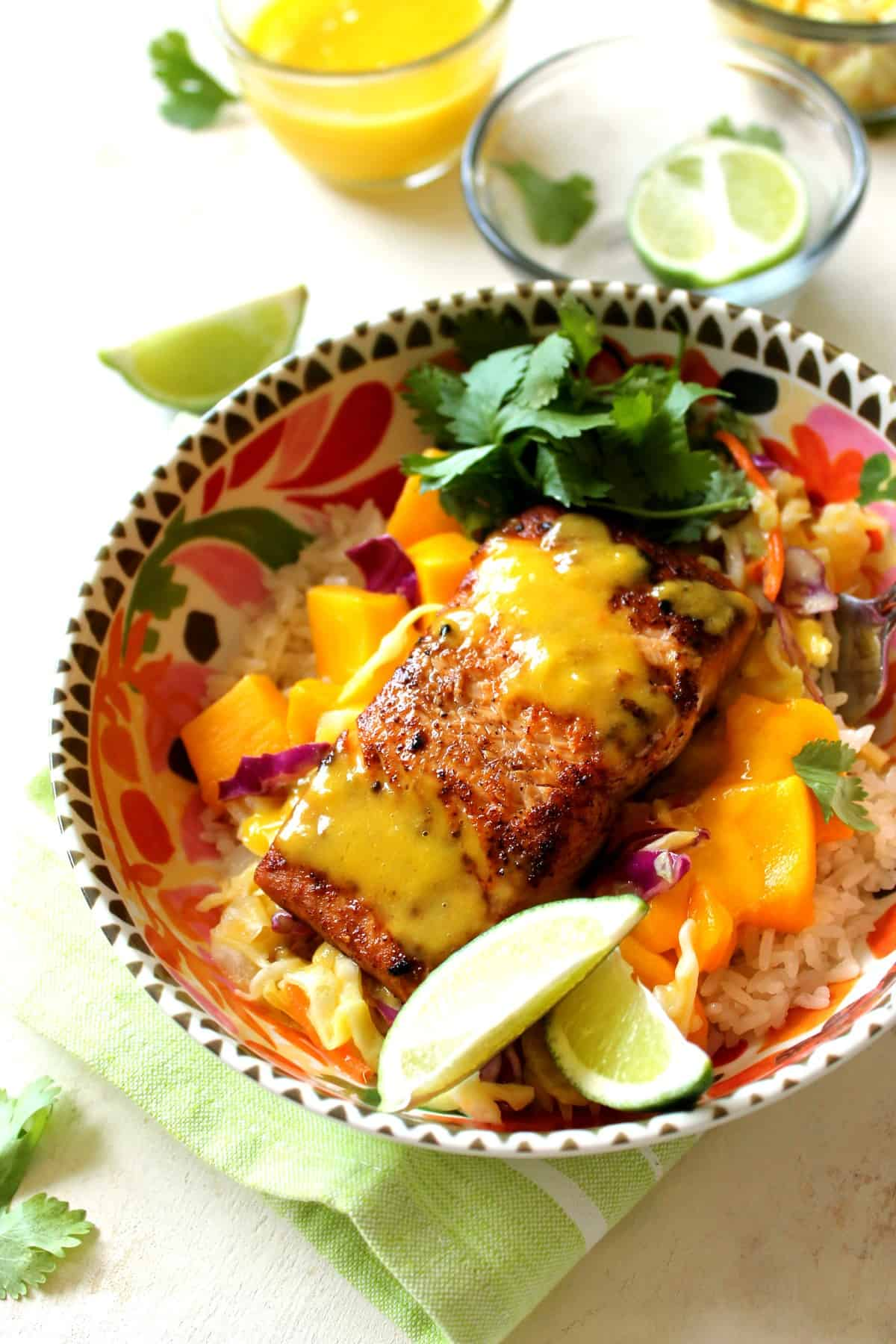 Mango Salmon Bowls with Coconut Rice make for a healthy, hearty summer meal that captures the flavors of steamy summer nights in the tropics!