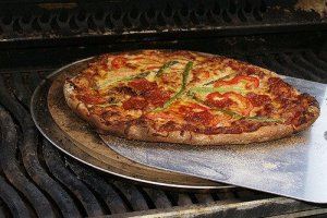 Grilling on a pizza stone = perfect pizza every time.