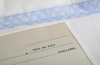 A paycheck shows 584 dollars and 36 cents.