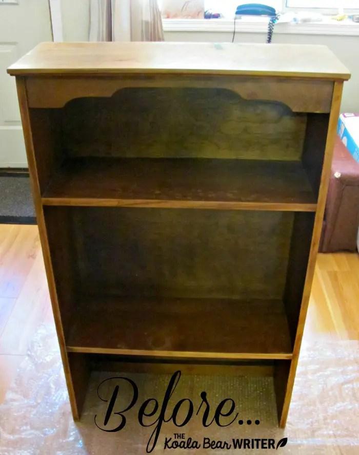 A brown wood bookshelf before chalk painting