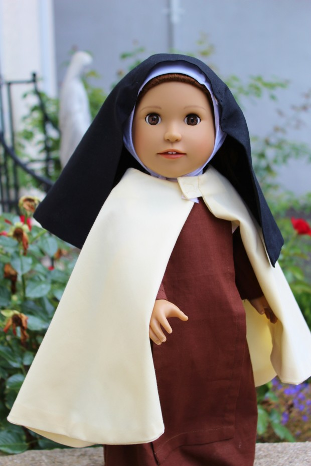 St. Therese doll with outfit and book in the Dolls from Heaven collection