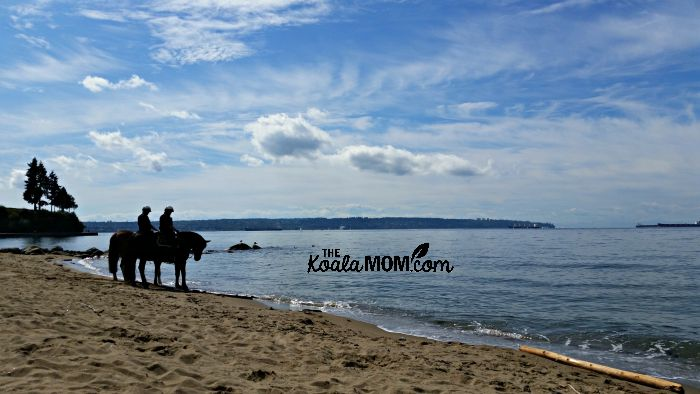 Mounted police on Third Beach at Stanley Park