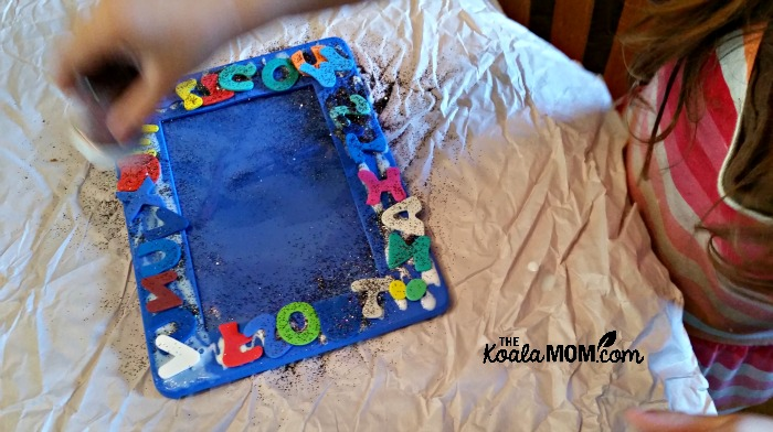 Adding alphabet stickers and glitter to a photo frame