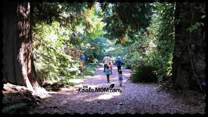 Family group walking through UBC Botanical Gardens