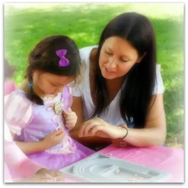 Esther doing a rosary bracelet workshop