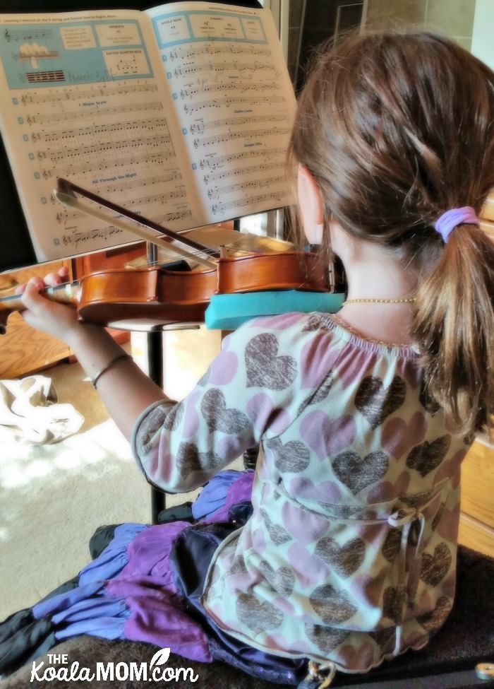 Sunshine playing violin before her weekly violin lessons