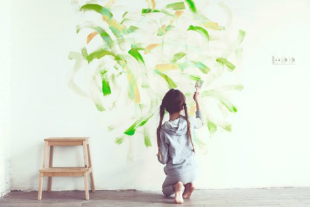 Child painting walls