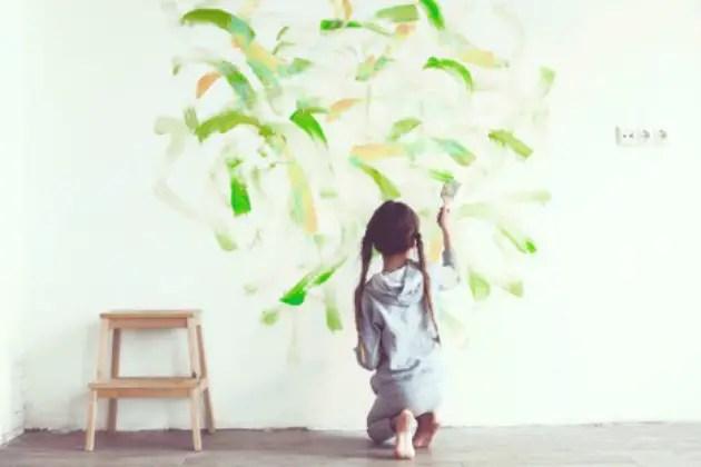 Child painting walls
