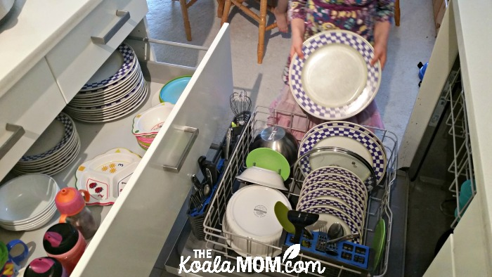 Lily unloads the dishwasher on her kitchen day