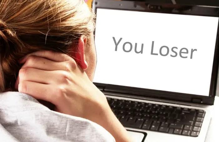 Girl facing cyber bullies via her laptop