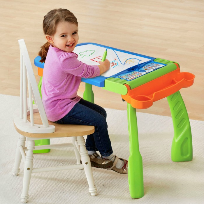 Girl drawing at a DigiArt Creative Easel, one of the VTech toys in my Christmas Gift Guide