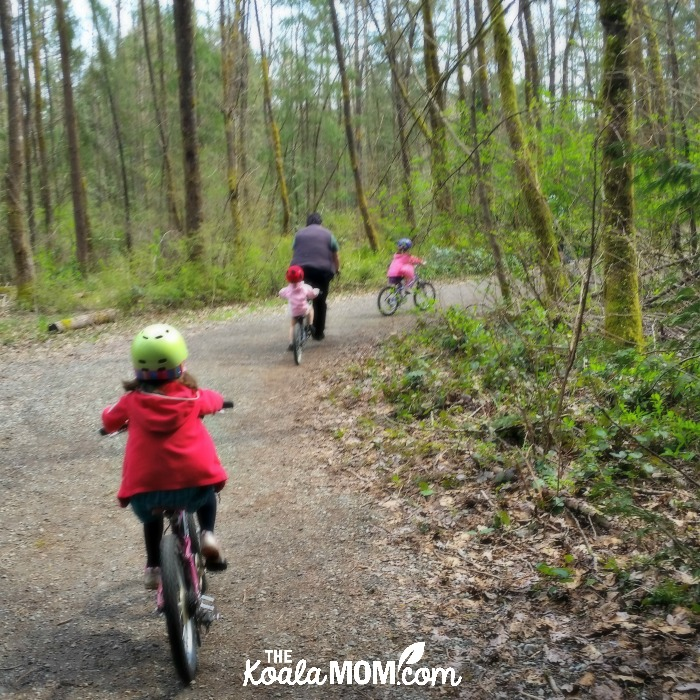 Our family biking together on a trail in Vancouver, BC