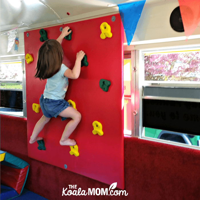 Toddler climbing a wall in the Vancouver Tumblebus