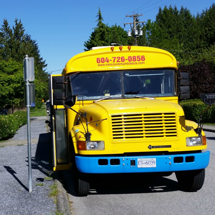 Vancouver Tumblebus parked on the street while kids play inside
