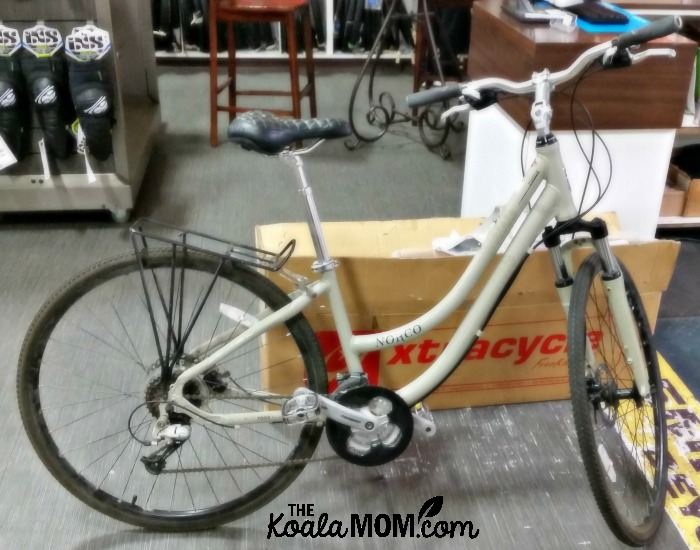 Norco hybrid bike beside an Xtracycle cargo bike conversion kit