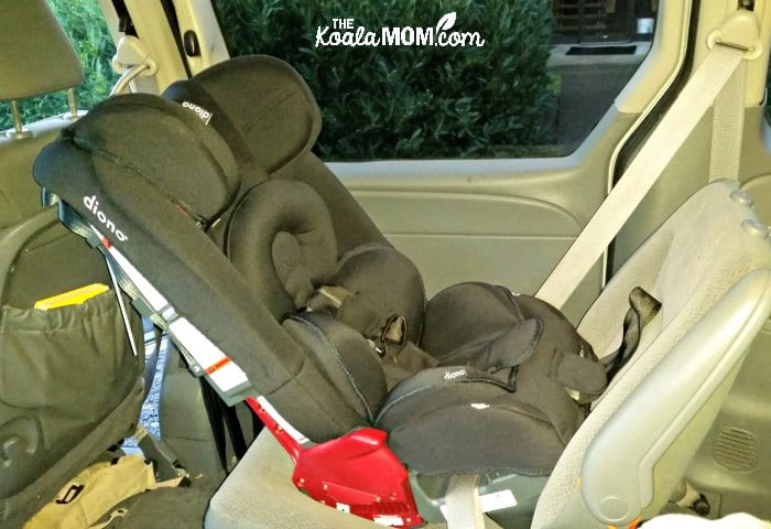 Rear-facing Diono Radian RXT car seat installed in a Dodge Grand caravan