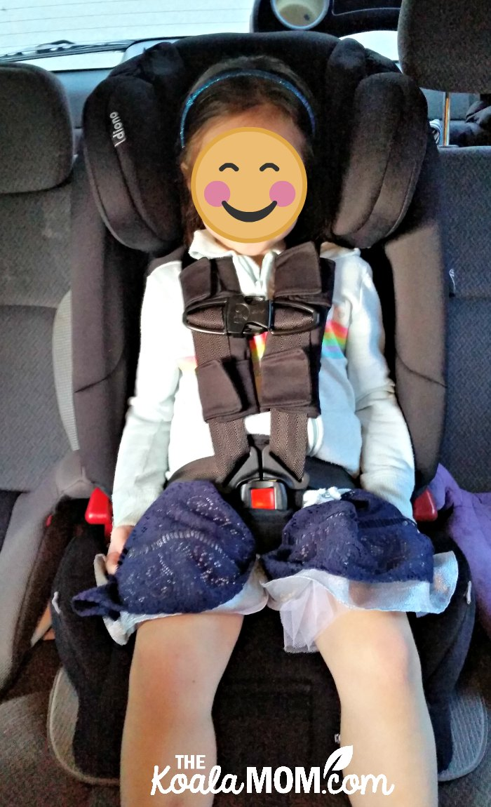 Four-year-old sitting in the Diono Radian RXT car seat with a five-point harness.