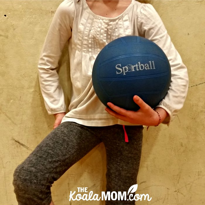 Girl holding a Sportball volleyball.
