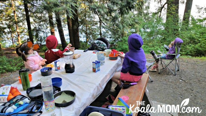 Kids eating a meal at Cultus Lake Campground.