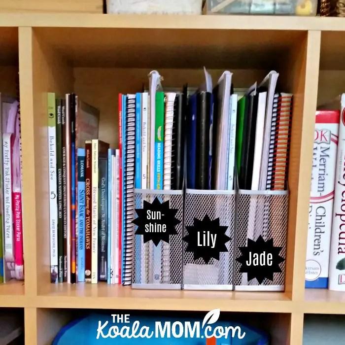 Magazine holders to organize the girls' workbooks.