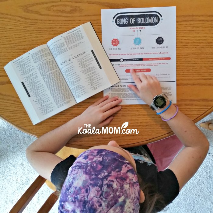 Sunshine (age 10) using the Books of the Bible at-a-glance printables while reading her Bible.