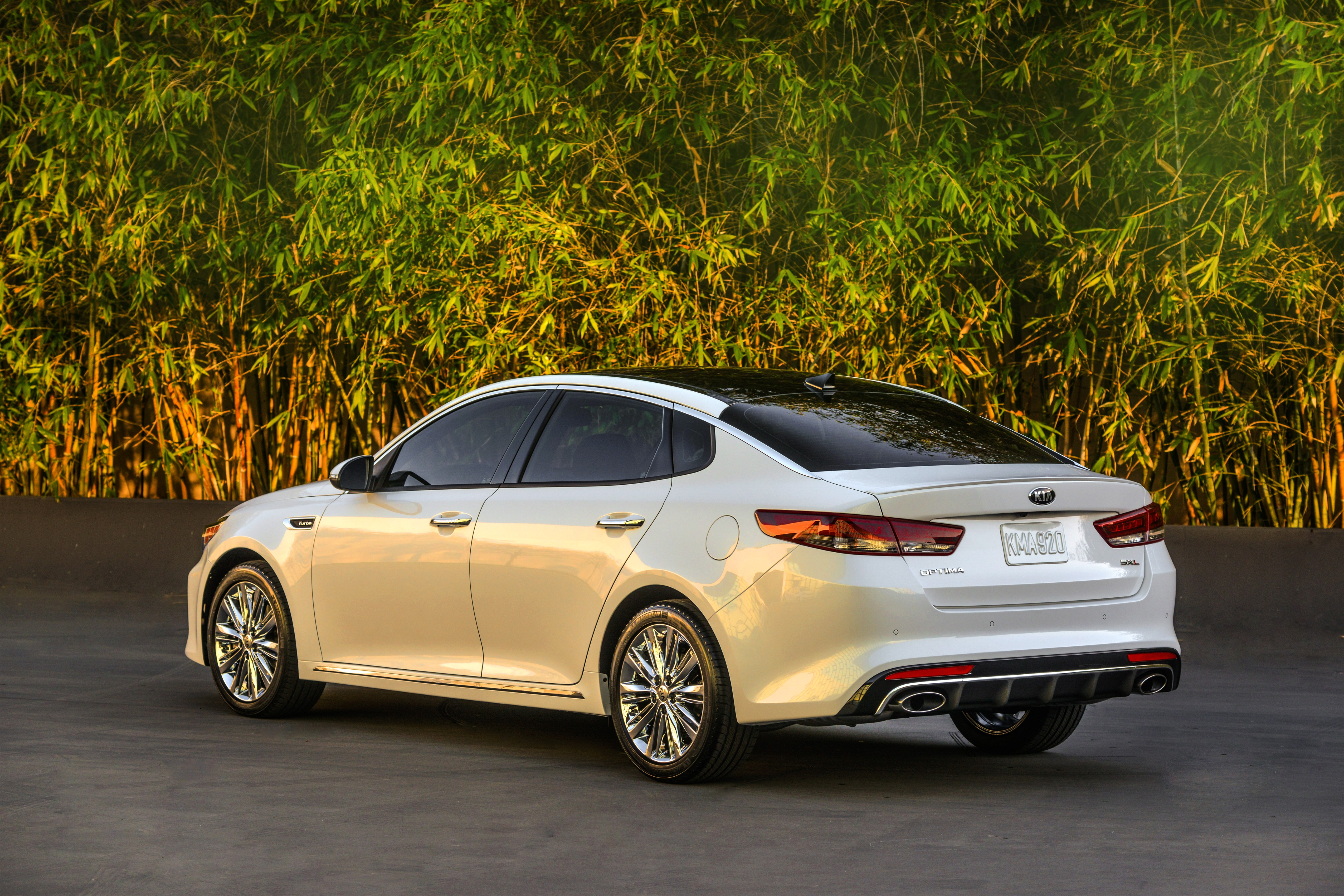 test spin review quick side sxl optima sx limited kia drive