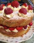 Victoria sponge with fresh cream and strawberries