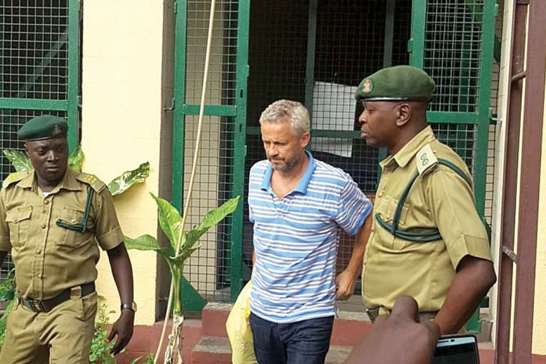 Image result for Lagos arraigns Danish man who allegedly killed Nigerian wife, daughter