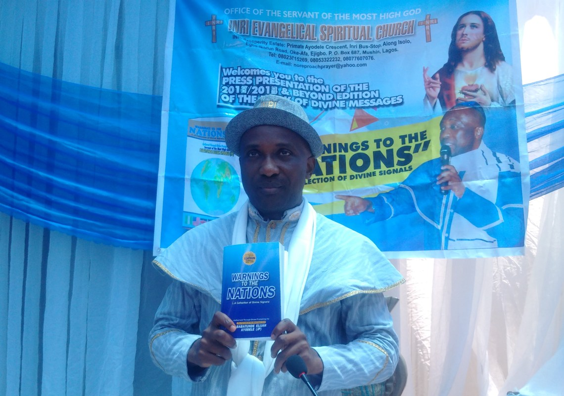 Primate Ayodele with the prophetic book