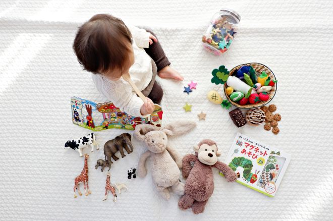 Child playing with animals and other toys.