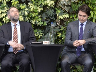 "NDP Leader Tom Mulcair and Liberal Leader Justin Trudeau attend a panel discussion at the ""iVote - jeVote"" event in Ottawa, Tuesday March 25, 2014. THE CANADIAN PRESS/Adrian Wyld"