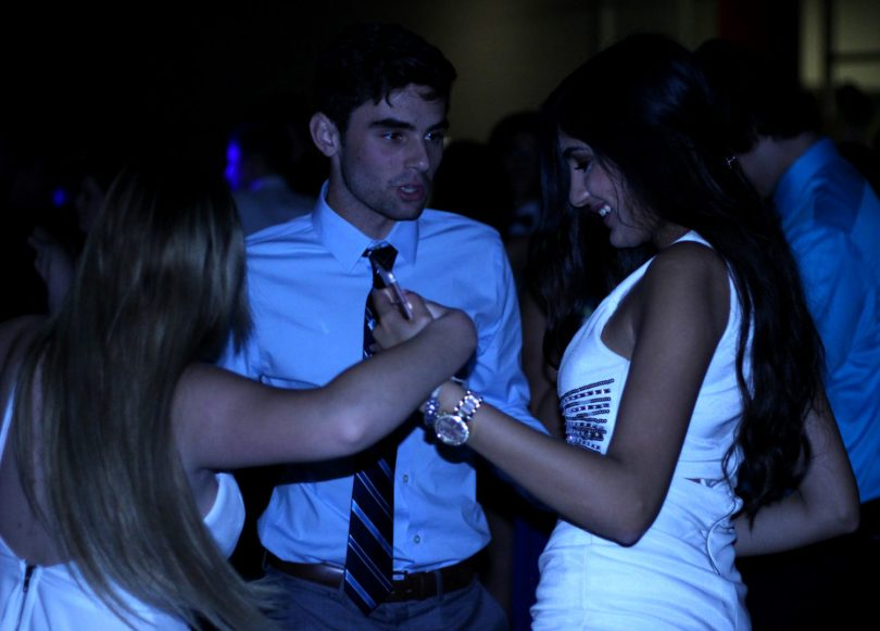 Students gather at the Sadie Hawkins dance. Photo by Karina Blodnieks