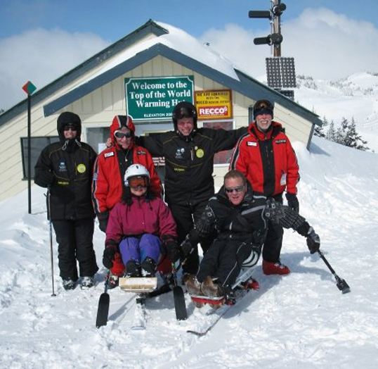 Anya McRae (left front) with adaptive sports advocate Paul Speight and her instructors at Sun Peaks Ski Resort. Photo courtesy of Anya McRae