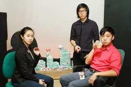 Natalie Gan, Milton Lim and Remy Siu (left to right) in front of their mahjong installation at the Vancouver Asian Candatian Theatre. Their installation references an original work called eatingthegame, where they discuss China's role in the Canadian economy bu using more than 800 mahjong tiles to build a set on Stage. | Photo by Sheng Ho