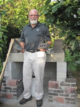 Bert Mollica with his brick oven, three months into the project | Photo by Sasha Lallouz