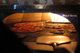 Pizzas baking in a brick oven | Photo by Frank Swift, Flickr.