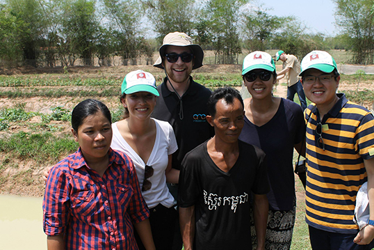 Maricel Saenz, Lawrence Leung, Mr Khon Son and Ms. Nuong Norm with Cambodian farmers.