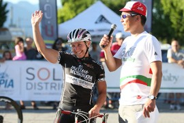 Laura Van Gilder waves to the crowd after her 3rd place podium finish
