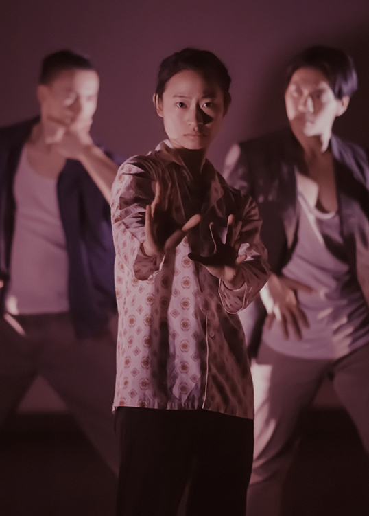 Performers Michelle Lui, Alex Tam, and Milton Lim in dance piece NINEEIGHT, choreographed by Natalie Tin Yin Gan with media and sound by Remy Siu.| Photo by Sepehr Samimi