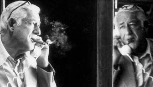 bill lookin in mirror with cigar